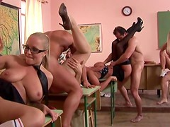 Beautiful women in a classroom orgy
