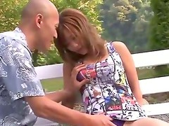 Shy Aika in the park naked on her knees giving a blowjob