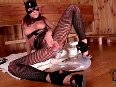 Kitty cat girl takes milk in the pussy
