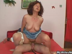 Old redhead sits on hard young boner