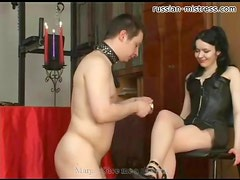 Abusive goddess in leather makes him hurt