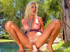 Sexy wet Puma Swede fucks huge dildo