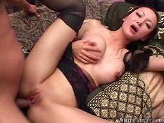 Busty Asian prostitute getting fucked from behind