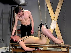 Bound gay submissive used for pleasure
