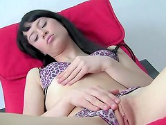 Veronique E is sitting on the chair and fingering her puss