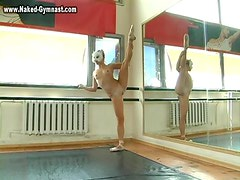 Ballet dancer warms up and strips naked