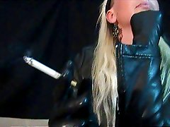 Hot blonde Smoking in full leather