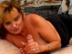 Mature with soft hands strokes a dick