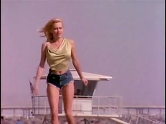 Vintage blonde Karen Foster poses for the cam in her denim shorts