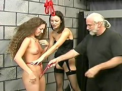 Smacking tits of a BDSM girl
