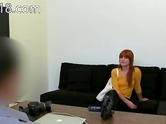 Redhead princess undress on black couch