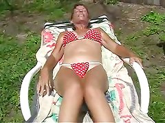 milf playing on sunlounger