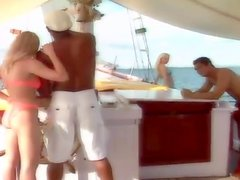 Two couples having great sex on a sailing ship in the middle of the ocean