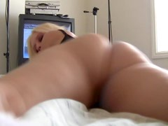 Horny blonde in tiny panties exposes her pussy
