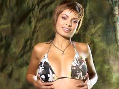 Short-haired hottie Aisha Jamal shows off her natural beauty