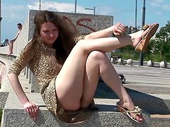 Girl in a dress flashes her pussy