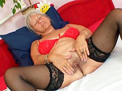 Sexy granny in stockings masturbating her sweet pussy