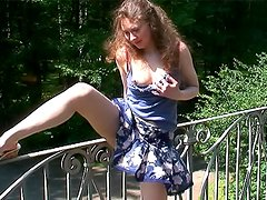 Girl in short skirt flashes pussy outdoors