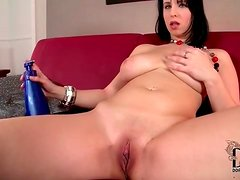 She rubs lotion into her shaved pussy and big tits