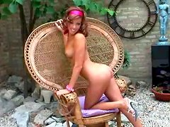 Tonya Berrios poses in the backyard sitting on a chair