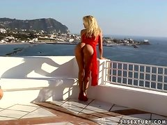 Gorgeous blond beauty in red dress shows her ass