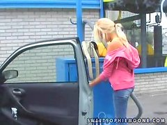 Lovely and innocent blondie Sophie is washing her car