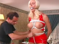 Red latex on tied up slave girl