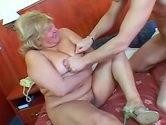 Fat mature jiggles as he fucks her pussy