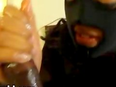 MILF wearing a mask and sucks huge black cock