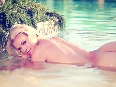 Wonderful blonde poses in water