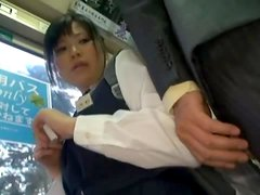 Japanese schoolgirl gets fucked in standing position in a bus