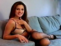 Sexy brunette lying on the sofa and masturbating