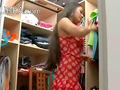 Exotic teen in shoes strip in a closet