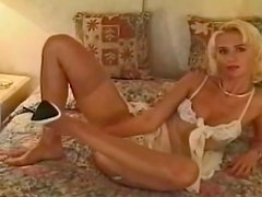 Hot curly skinny blonde  lying on the bed