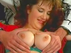 Curly busty redhead Jane is making nice blowjob
