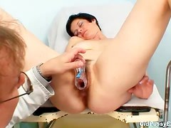 Hairy mature gets a speculum exam