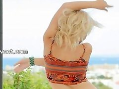 sweet blonde making outdoor undressing