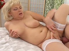 Horny grandma seduces this young man and pays him cash