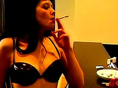 Dark-haired nurse smoking hot in her apartment