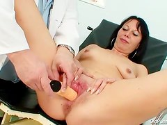 Small tits mature gets a pussy exam