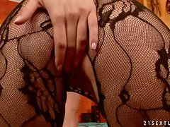Blonde With Crotchless Pantyhose Sticks Dildo In Her Gash