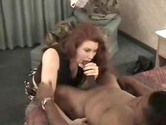 Elegant redhead amateur sucks on thick black dick