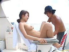Naughty and busty babe in bikini making out and fucking on the yacht