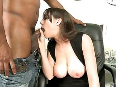This pale skinned and buxom milf