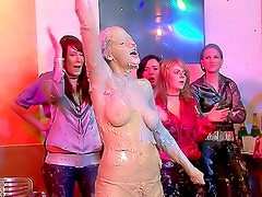 Milky goo poured on hot women