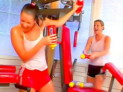 Water bottle spraying with sporty girls