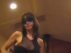 Masked milf dances and plays with her pussy