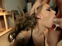 Deepthroat fucking a big tits tattooed slut