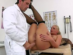 Doctor Manuel Ferrara seduces horny patient Phoenix Marie and makes her blow his cock
