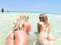 Alluring blondes Alexis Texas and Phoenix Marie are showing off their hot booties at the beach